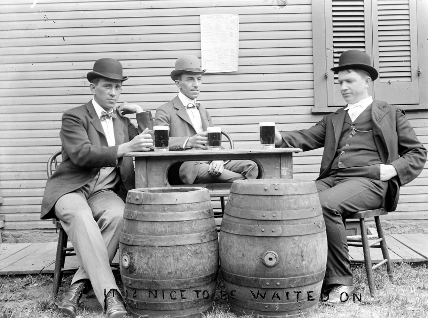 Men in bowlers drinking beer
