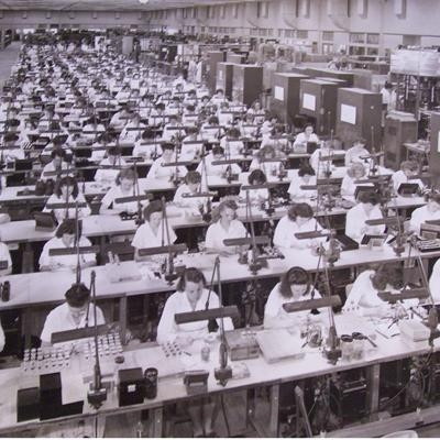 Female workers manufacturing transistors