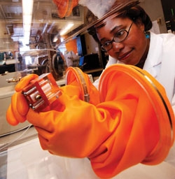 Paula Hammond works a small-scale experimental fuel cell under tightly controlled conditions.