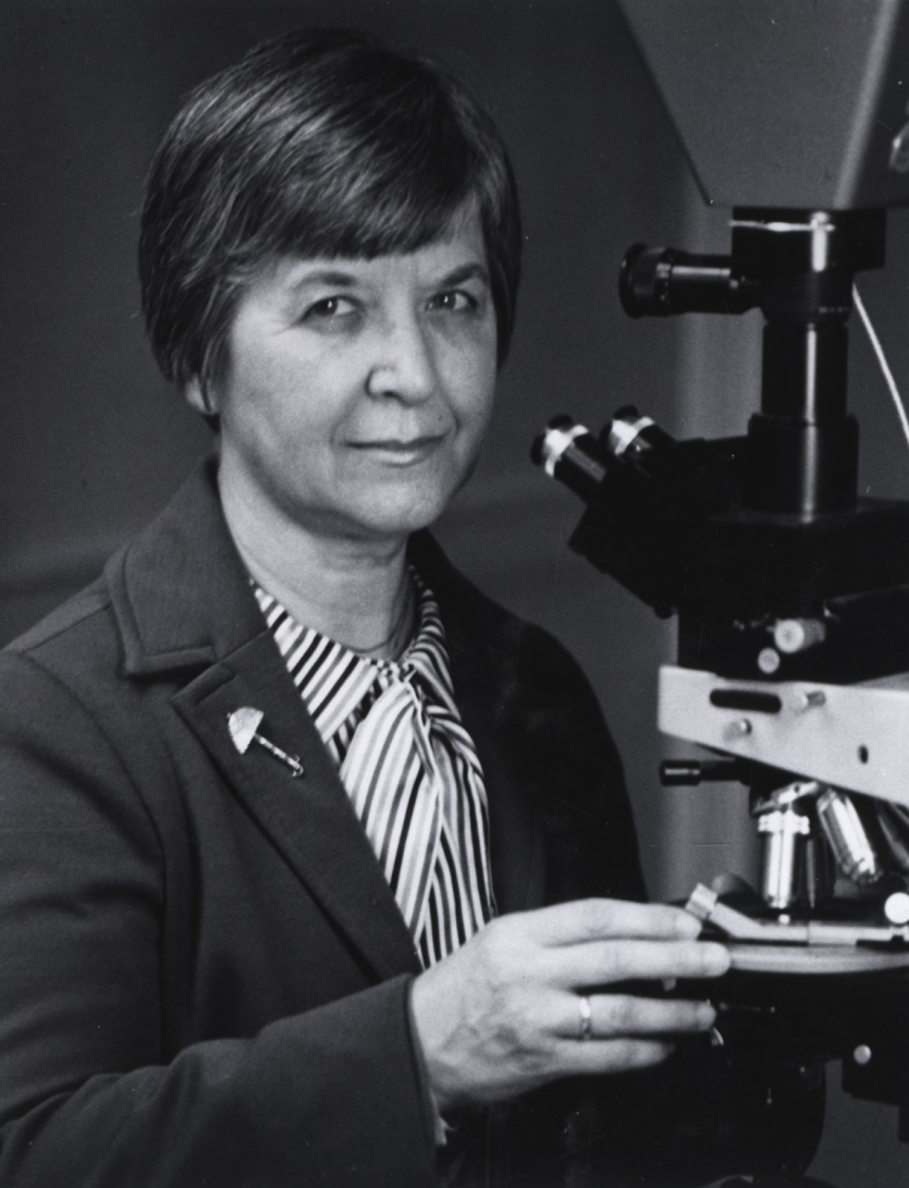 Stephanie Kwolek at a polarizing microscope. Gift of Stephanie Kwolek. Courtesy DuPont.