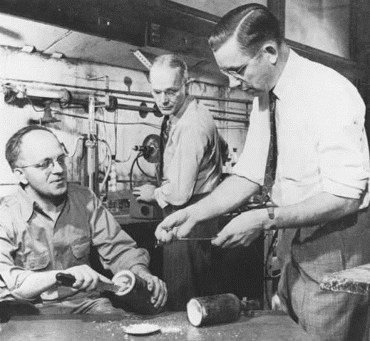 Reenactment of the 1938 discovery of Teflon. Left to right: Jack Rebok, Robert McHarness, and Roy Plunkett.
