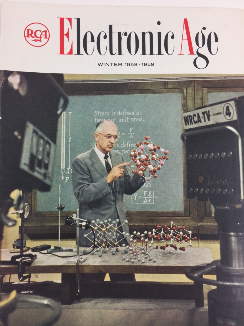 A man holds up a model of the molecular structure of crystals.