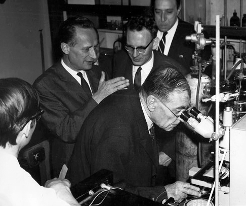 Group of men in a scientific lab