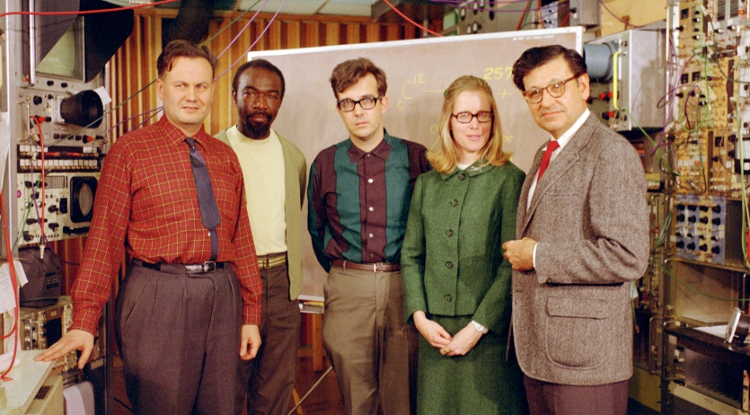 color photo of five posed in a lab