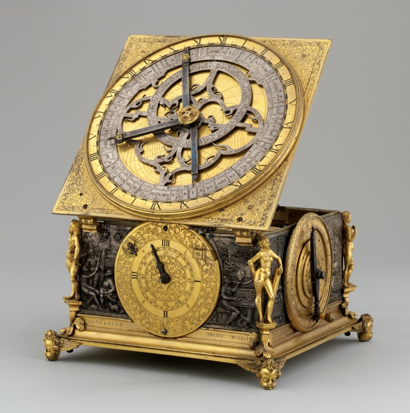 Ornate brass and steel clock-like instrument