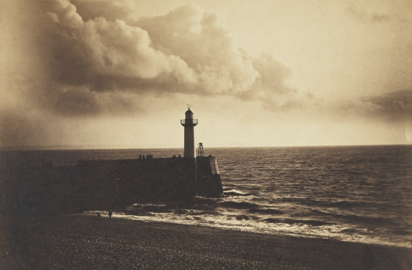 black and white photo of lighthouse and sea
