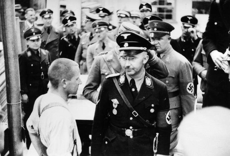 Heinrich Himmler standing with other Nazis