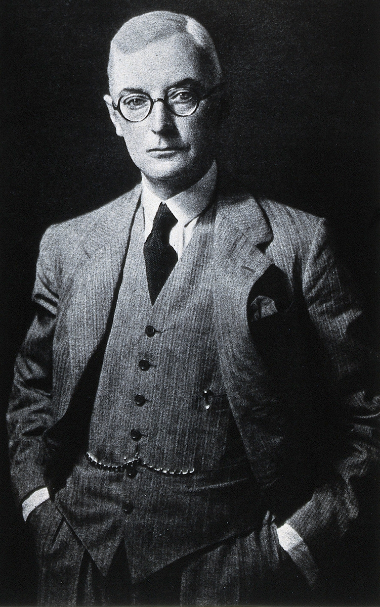 Black and white portrait of man in suit and glasses