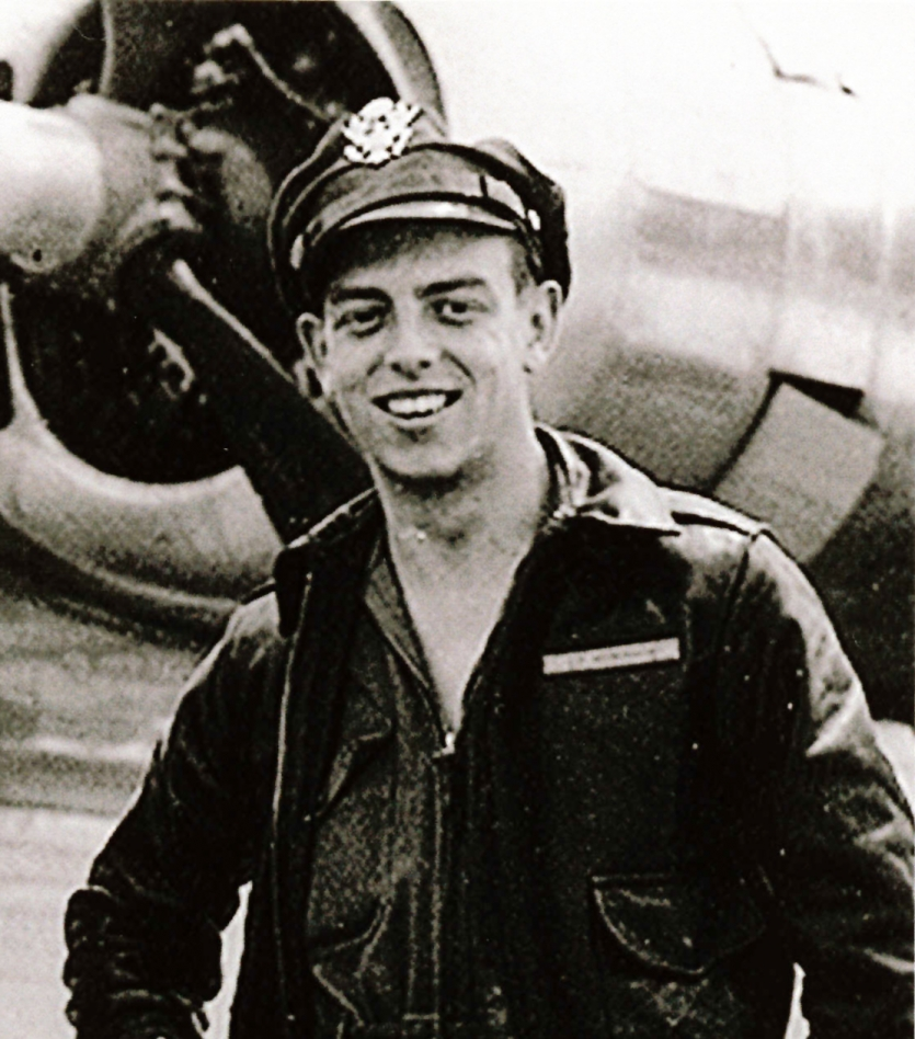 Black and white portrait of a man in a pilot's uniform