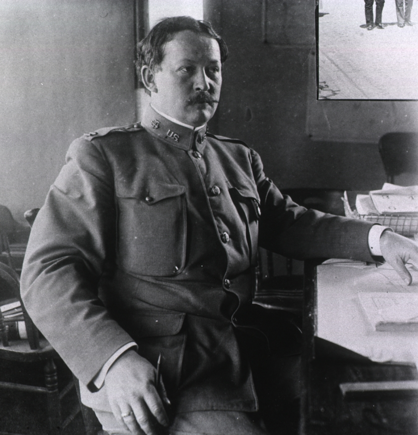 Photo of mustachioed white man in uniform