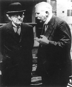 J. J. Thomson (left) and Ernest Rutherford in the 1930s.